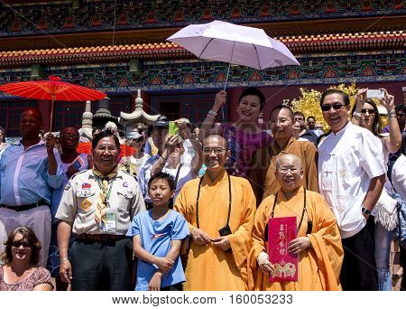 Bronkhorstspruit, South Africa - February 06, 2016: Buddhist Masters and other people are watching the Chinese New Year Parade next to the Chinese Nan Hua Temple in South Africa. A part of ethnic Chinese culture.
