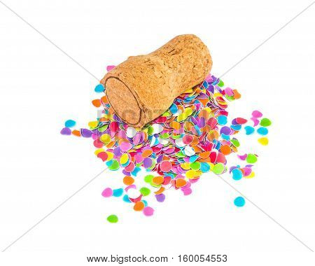 Champagne cork lying on the small heap of confetti isolated over white. Holidays and events concept.