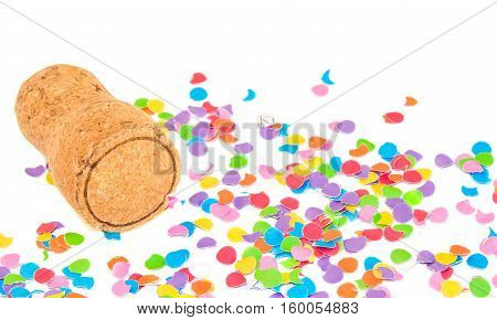 Champagne cork on confetti background. Holidays and events concept.