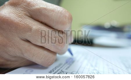 Close up of hand over documents ready to sign them