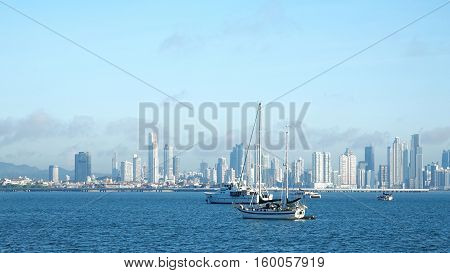 Several boats anchored near Amador Causeway with the ever growing City of Panama in the background