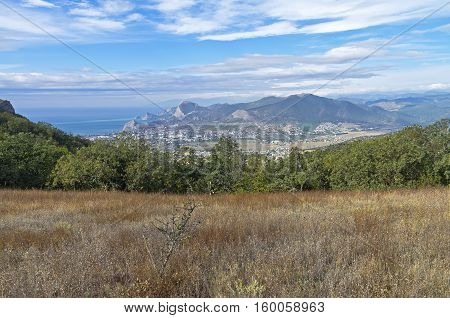 A small meadow on the of Mount Ai-Giorgi. View of the valley and the resort town of Sudak. Crimea September.