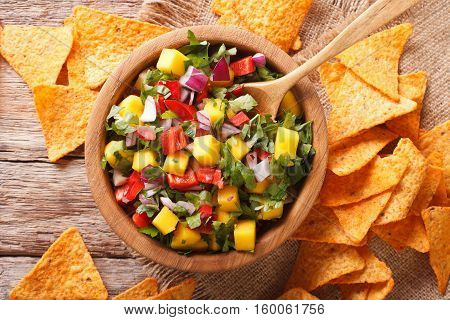 Salsa With Mangoes, Peppers, Cilantro And Onion Closeup And Nachos. Horizontal Top View