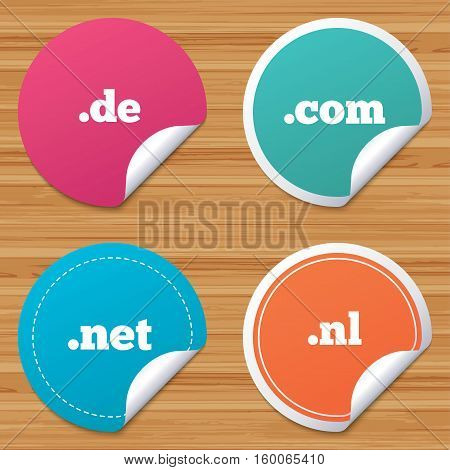 Round stickers or website banners. Top-level internet domain icons. De, Com, Net and Nl symbols. Unique national DNS names. Circle badges with bended corner. Vector