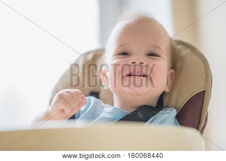 baby smiling mother all mired in slush