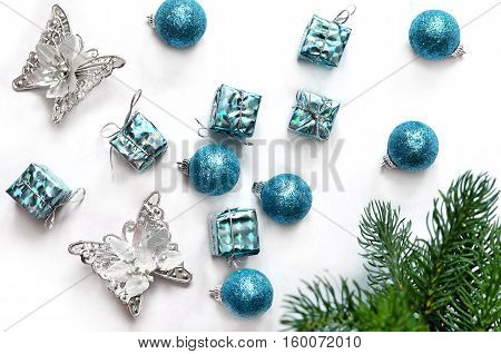 Christmas composition. Christmas gift balls butterfly and fir tree branches. Top view flat lay