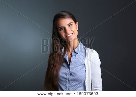 Portrait of a businesswoman , against dark background