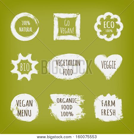 A set of stickers with the text Go Vegan 100% Natural Eco Bio Vegetarian Food Veggie Menu Organic Farm Fresh. White label isolated on green background.