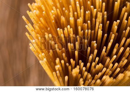 Yellow Long Spaghetti Integral On A Rustic Background. Yellow Italian Pasta.
