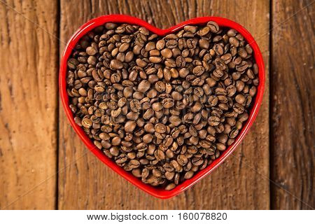 Coffee Love Concept. Coffee Beans In Heart Into The Bown