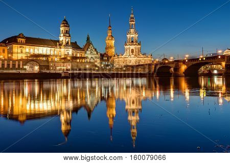 Hofkirche and palace at the river Elbe in Dresden at night