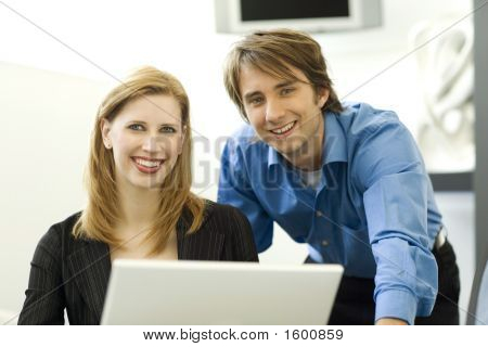 Workers Work Together With A Laptop