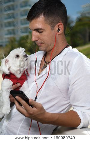 Man in headphones with his cool little dog