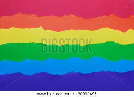 Rainbow flag made of paper LGBT symbol colorful background