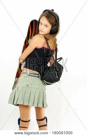 mischievous girl in a short skirt with a skateboard