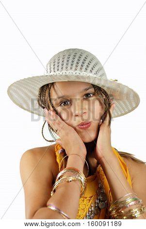 mischievous little girl in a straw hat