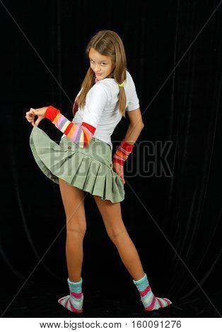 mischievous girl model posing in the studio