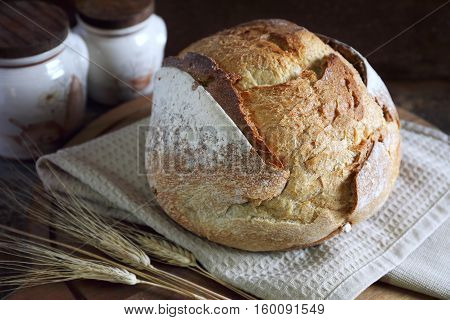 French country bread dark wooden chopping board rustic style