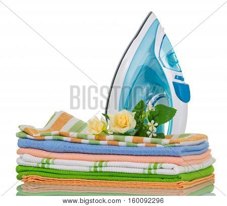 Clean ironed clothes and iron blue isolated on white background