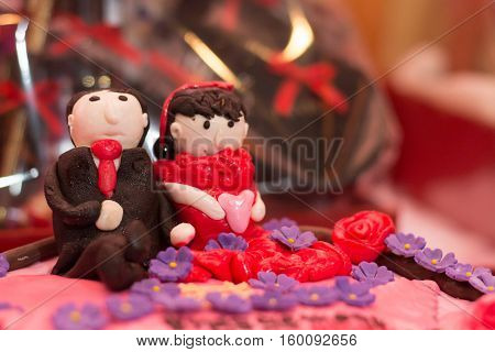 Tart cake decorated with couple boy and girl love icing sugar