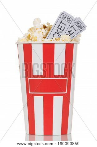 Large striped popcorn box and gray movie ticket isolated on white background