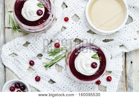 cranberry sauce Greek yogurt parfait on wood background