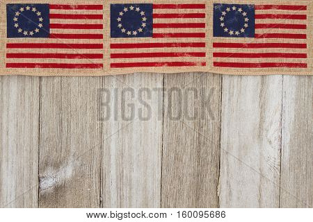 USA patriotic old Betsy Ross flag and weathered wood background with copy space for your message
