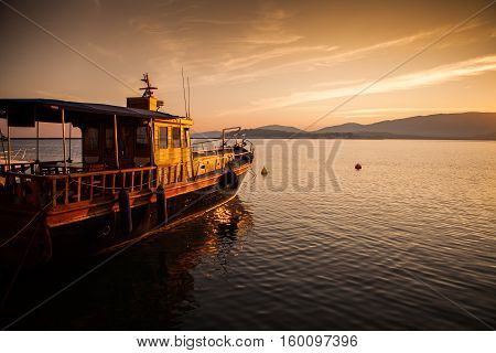 Wooden Boat Ready to sail at Sunset Time
