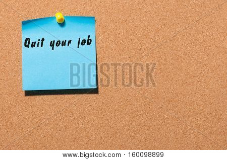 Quit your job - motivate inscription on blue sticker pinned at cork notice board. With empty space for text.