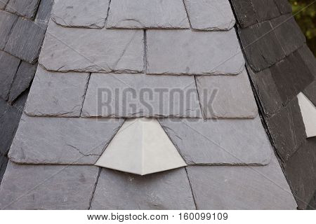 New slate roof tiles background close up