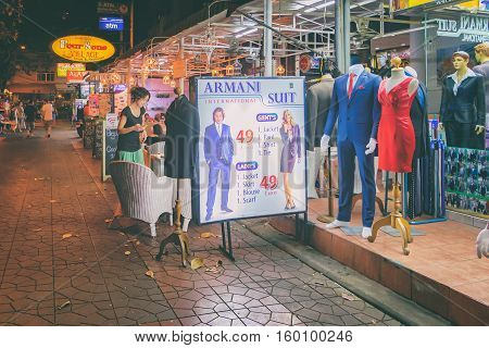 Bangkok, Thailand - January 11, 2016: Tailor services and suits for tourists at Rambuttri Alley, a popular food street close to Khaosan road and famous district for back packer and budget tourist.