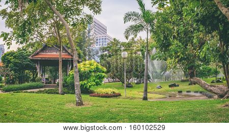 Bangkok, Thailand - December 23, 2015: Panorama view of Bangkok skyline from Lumphini Park Thailand. Lumphini Park is a popular place for walks and sport activities.