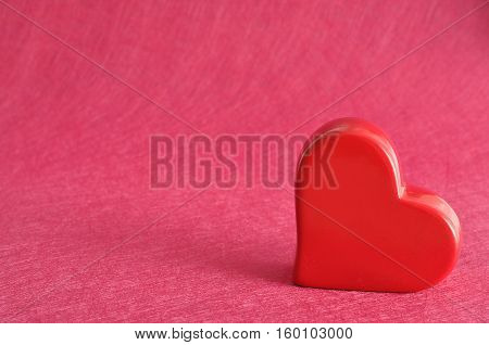 Valentine's Day. Red heart isolated against a pink background