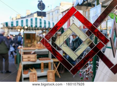 Broad Street Oxford United Kingdom December 04 2016: Arts and Crafts Market with open stalls on Broad Street stall with stained glass art christmas pendants Oxford.