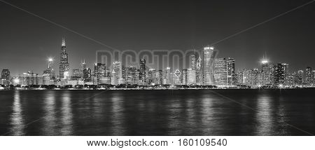 Black And White Panoramic Picture Of Chicago City Skyline At Night.