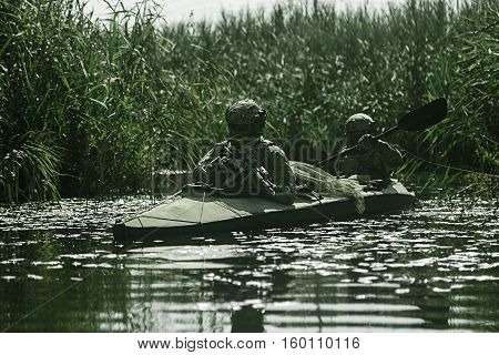 Special forces operators in the military kayak