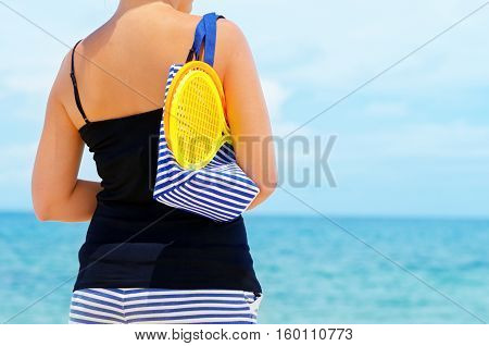 Young Woman With Rackets For Beach Tennis