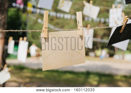Cards hang on a rope. Conceptual background. The festival outdoors. Memory message.