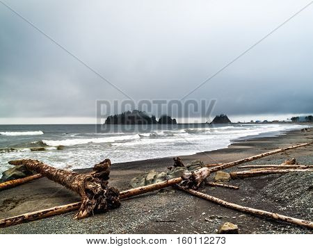 beachsmall islands and walkers in the beach off the Washington coast on the La Push Native American Reservation USA