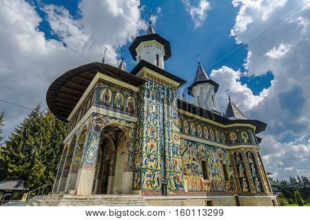 Colorful facade mural painted fresco at Neamt Monastery Romania