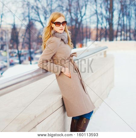 Fashion Beautiful Young Elegant Woman Wearing A Coat Jacket And Sunglasses In Winter City
