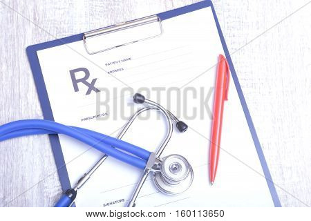 Closeup of stethoscope on a rx prescription.