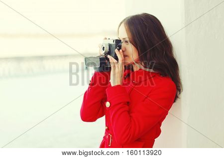 Young Woman Photographer Takes Picture On The Vintage Camera In Winter City