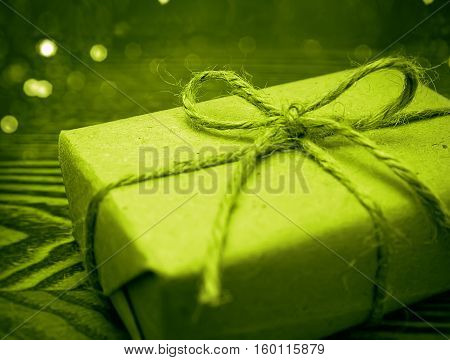 Gift wrapped in paper in the wooden backgroud