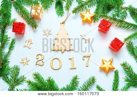 New Year 2017 background with 2017 figures Christmas toys green fir branches-New Year 2017 composition Concept of New Year 2017 holiday with New Year objects. Flat lay top view of 2017 still life