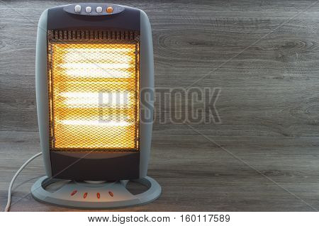Halogen Electric Stove illuminated and radiating on gray background