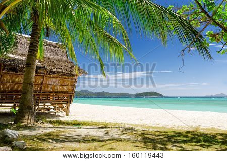 Bamboo Hut On A Tropical Beach