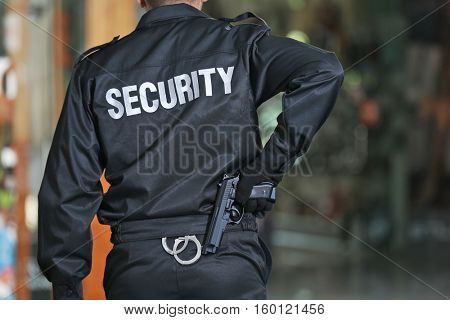 Security man standing indoors