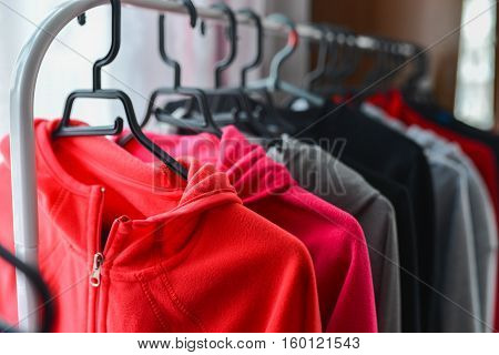 Warm colored sport jackets hanging at a fashion store.