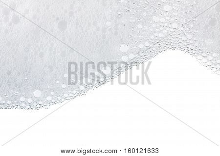 Foam bubbles abstract white background. Detergent close up